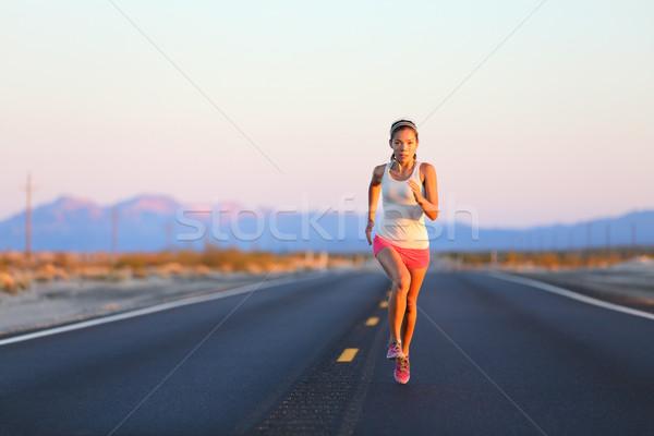 Running woman sprinting on road highway Stock photo © Maridav