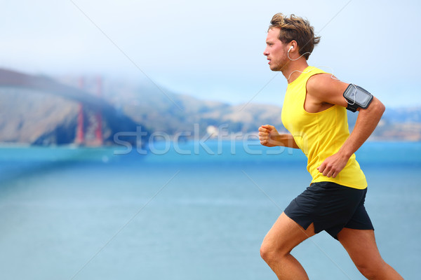 Athlete running man - male runner in San Francisco Stock photo © Maridav