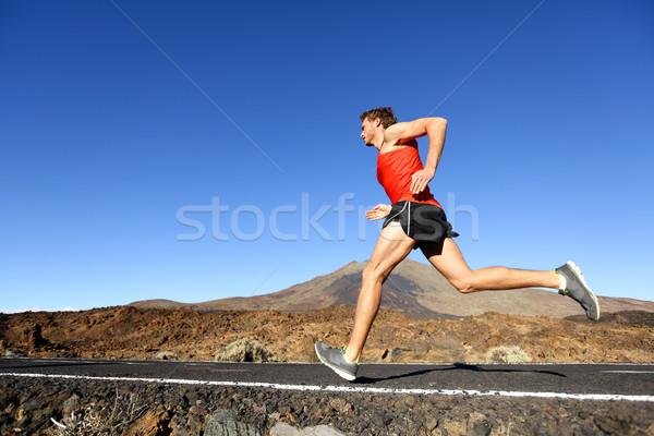 Sport running man - male runner training outdoors Stock photo © Maridav