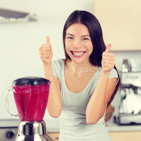 Smoothie woman making fruit smoothies thumbs up Stock photo © Maridav