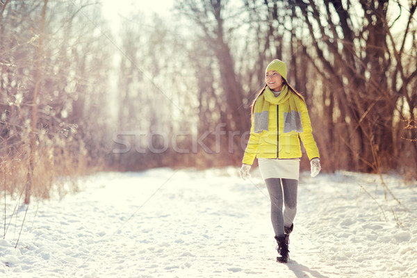 Winter lifestyle woman walking outdoors in forest Stock photo © Maridav