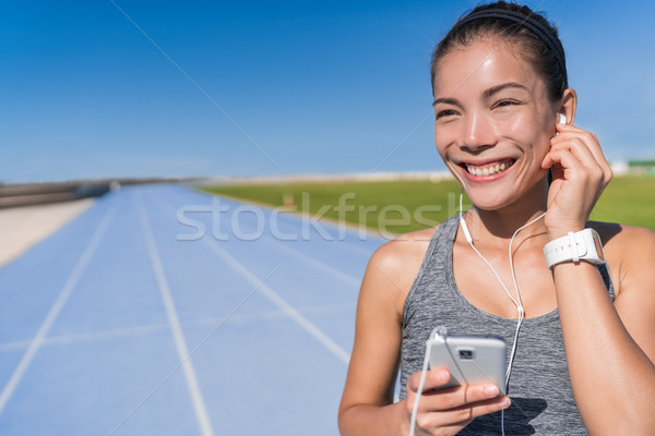 Asian runner listening to running motivation music Stock photo © Maridav
