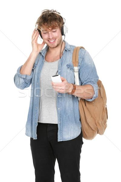 Egyetemi hallgató zenét hallgat fejhallgató okostelefon fiatal jóképű Stock fotó © Maridav