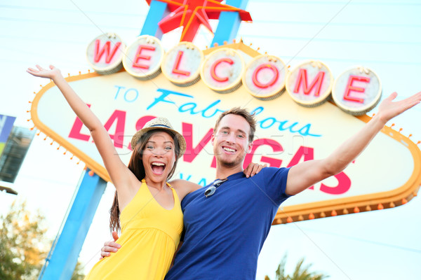 Las vegas people - couple happy cheering by sign Stock photo © Maridav