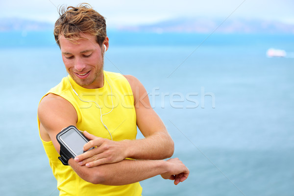 Running training music on smartphone app - runner Stock photo © Maridav