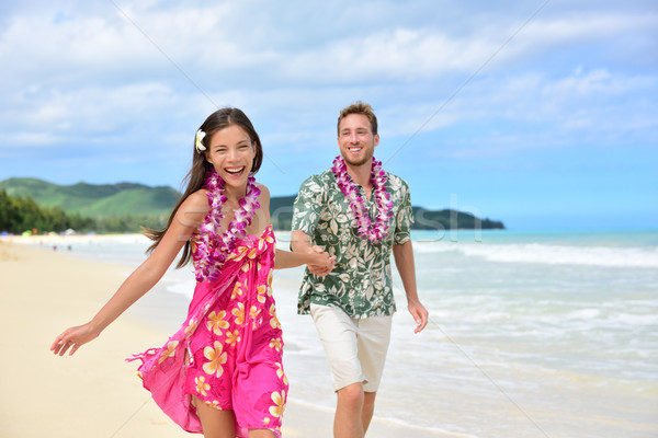 Fun couple on beach vacations in Hawaiian clothing Stock photo © Maridav
