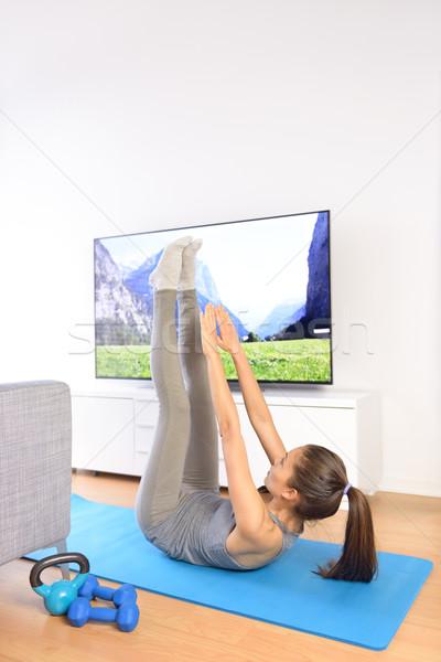 домой фитнес тренировки телевидение девушки палец Сток-фото © Maridav