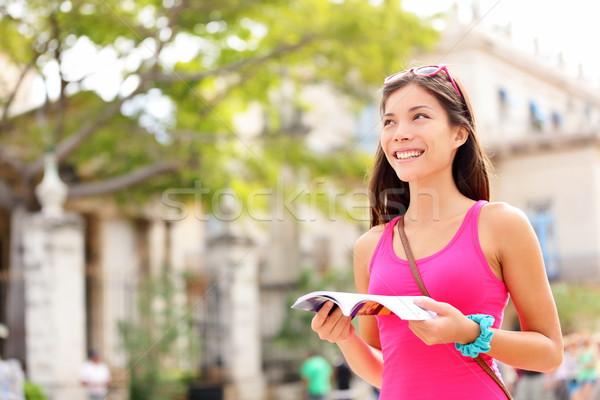 Tourist happy reading guide book Stock photo © Maridav