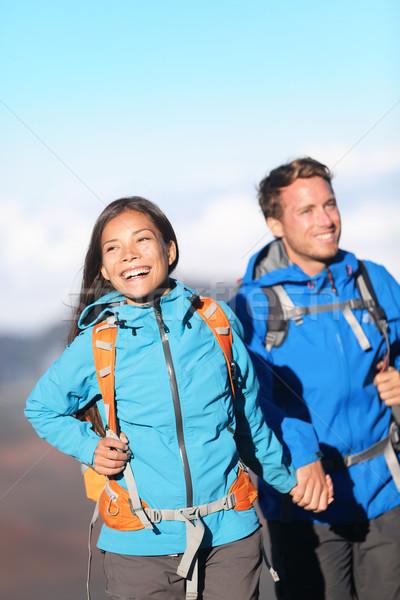 Happy interracial couple hiking Stock photo © Maridav