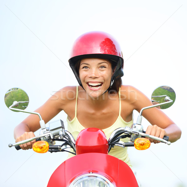 Excited woman on scooter happy Stock photo © Maridav