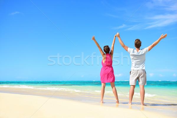 Stock photo: Happy free couple cheering on beach travel holiday