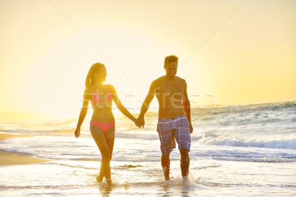 Balayı romantik çift sevmek plaj gün batımı Stok fotoğraf © Maridav