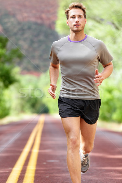 Man running on road - Sport and fitness runner Stock photo © Maridav