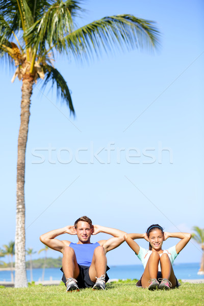 People training sit ups outside - fitness couple Stock photo © Maridav
