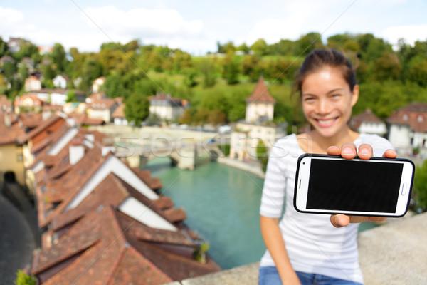 Smartphone screen - Woman showing app in Bern Stock photo © Maridav