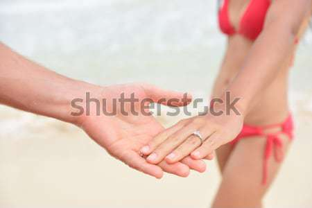 Stock photo: Newlyweds beach wedding concept - closeup of rings