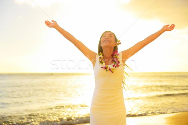 Happy carefree woman free in Hawaii beach sunset Stock photo © Maridav