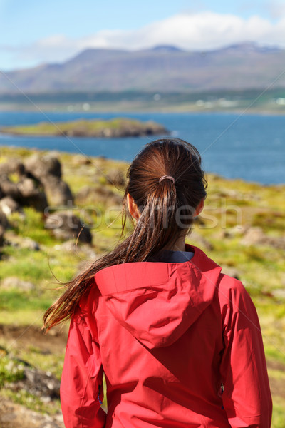 Hiking woman in hardshell jacket in Iceland nature Stock photo © Maridav