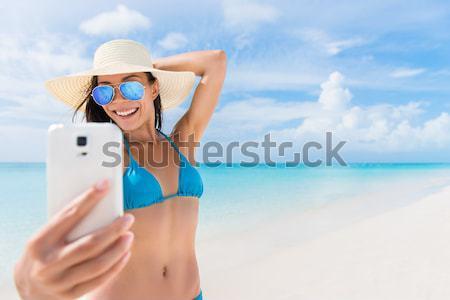 Stockfoto: Telefoon · meisje · foto · strand · vakantie