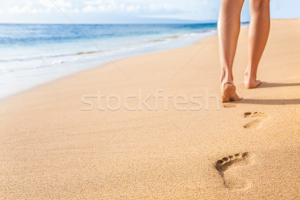 Beach sand footprints woman legs walking relaxing Stock photo © Maridav