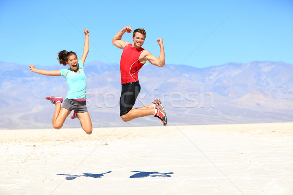 Siker fiatal futók ugrik izgatott ünnepel Stock fotó © Maridav