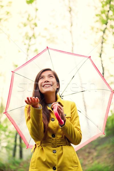 Asian Autumn woman happy after rain under umbrella Stock photo © Maridav