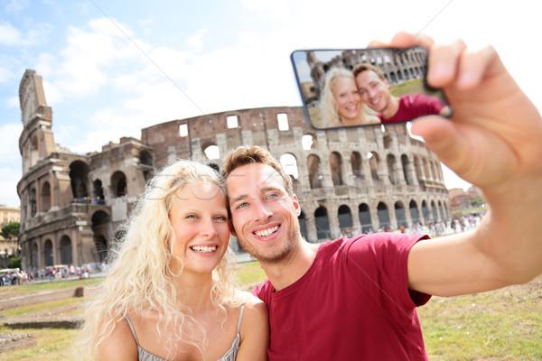 Tourist couple on travel in Rome by Coliseum Stock photo © Maridav