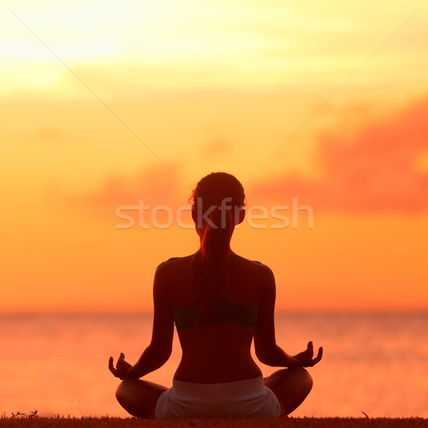 Meditation - Meditating yoga woman at beach sunset Stock photo © Maridav
