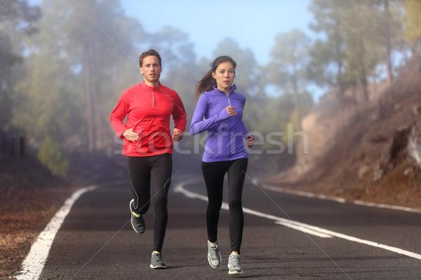 Healthy running runner man and woman workout Stock photo © Maridav