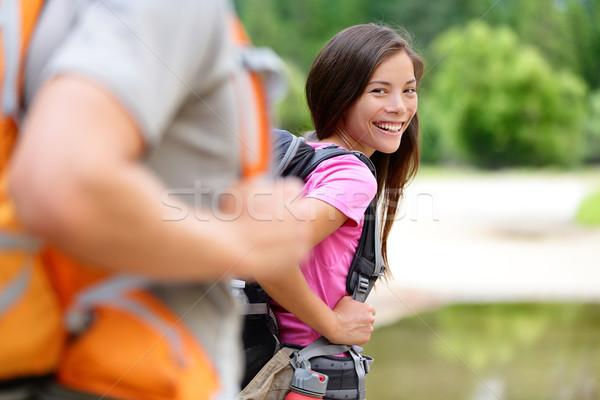 Hiker woman hiking happy smiling at camera Stock photo © Maridav