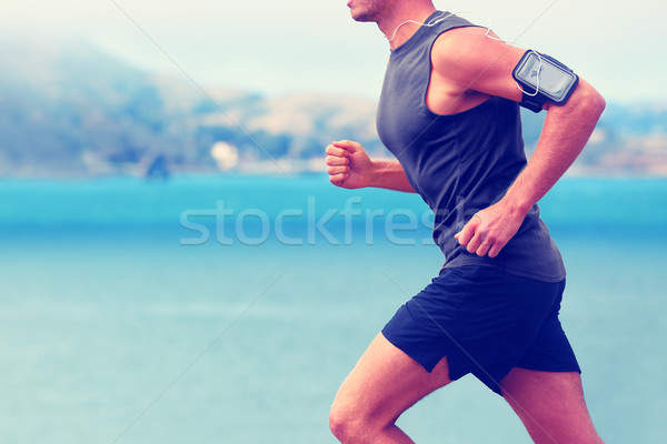 Cardio runner running listening smartphone music Stock photo © Maridav