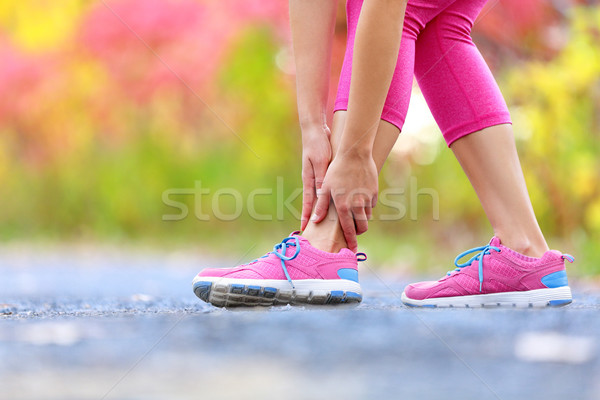 Stock photo: Running sport injury - twisted broken ankle