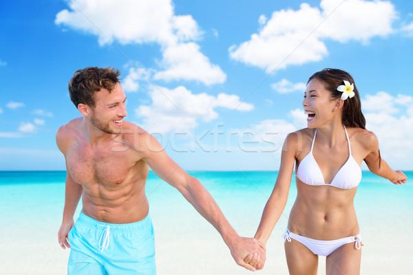 Beach vacation fun sexy couple in bikini swimwear Stock photo © Maridav