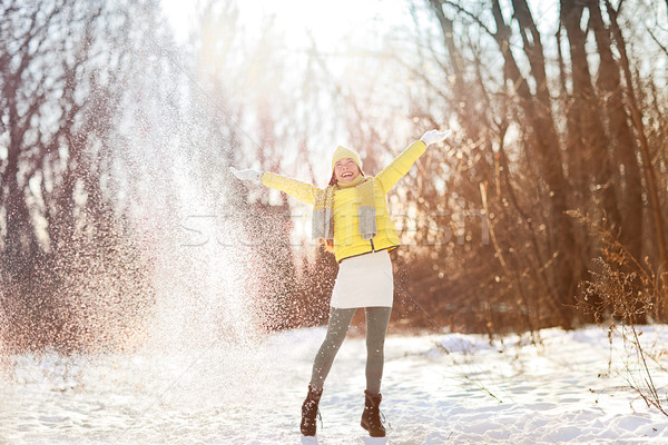 Happy winter snow fun woman playing free Stock photo © Maridav