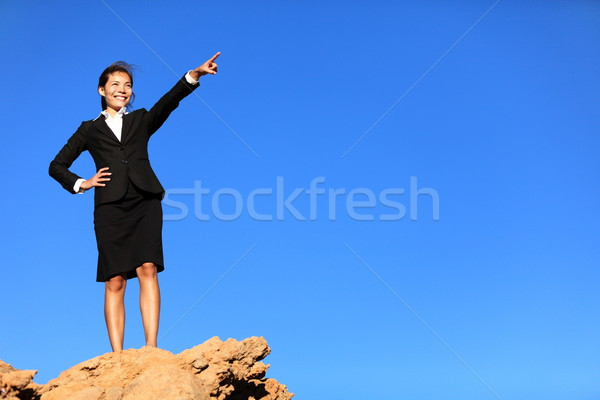Business concept - businesswoman pointing at future ahead Stock photo © Maridav