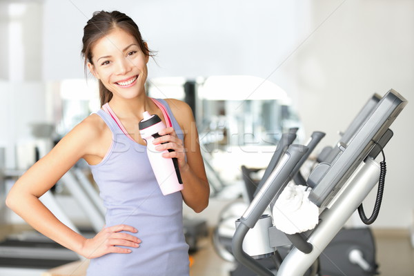 Stockfoto: Gymnasium · vrouw · training · drinkwater · glimlachend