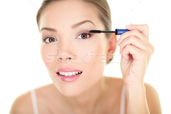Stock photo: Beauty makeup woman putting mascara eye make up