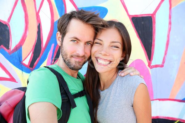 Happy couple selfie portrait, Berlin Wall, Germany Stock photo © Maridav