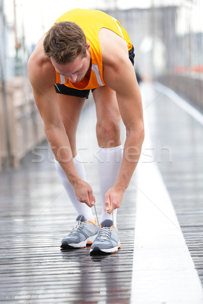 Runner man tying laces on running shoes, New York Stock photo © Maridav