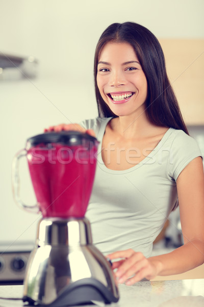 Berry smoothie woman making fruit smoothies Stock photo © Maridav