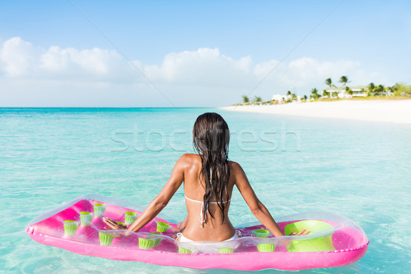 Beach woman floating on ocean water pool mattress  Stock photo © Maridav