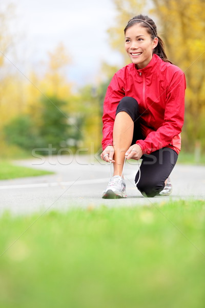 Runner woman tying running shoes Stock photo © Maridav