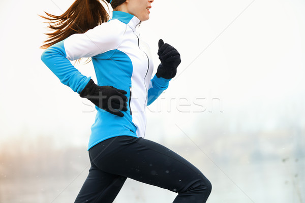 Running athlete in winter Stock photo © Maridav