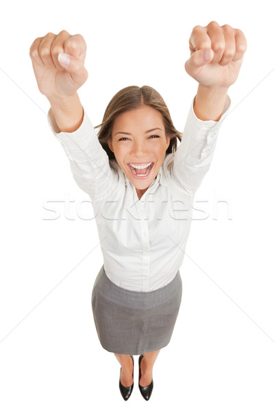 Ecstatic woman cheering and winning Stock photo © Maridav
