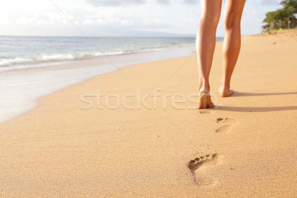 Stock photo: Beach travel - woman walking on sand beach closeup