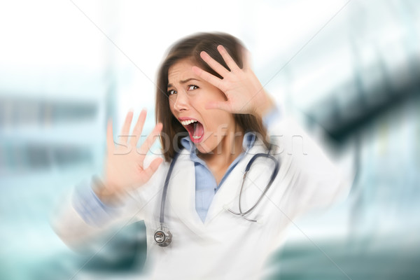 Surprised shocked scared doctor woman afraid Stock photo © Maridav