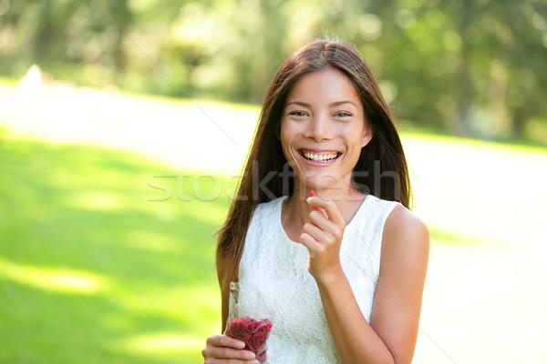 Woman eating goji berries Stock photo © Maridav