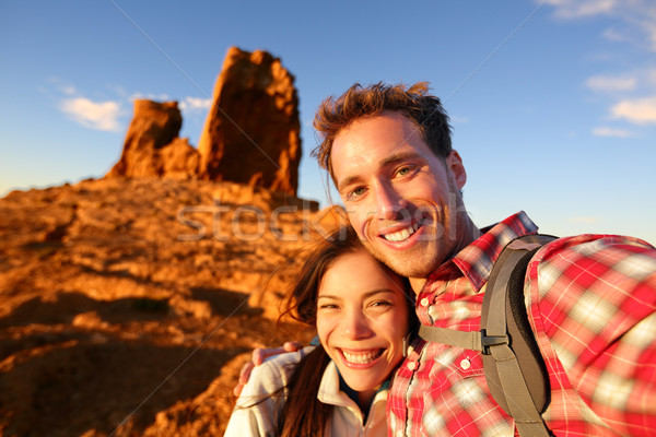 Happy couple taking selfie self portrait hiking Stock photo © Maridav