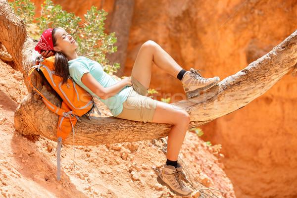 Resting relaxing woman hiker lying down Stock photo © Maridav