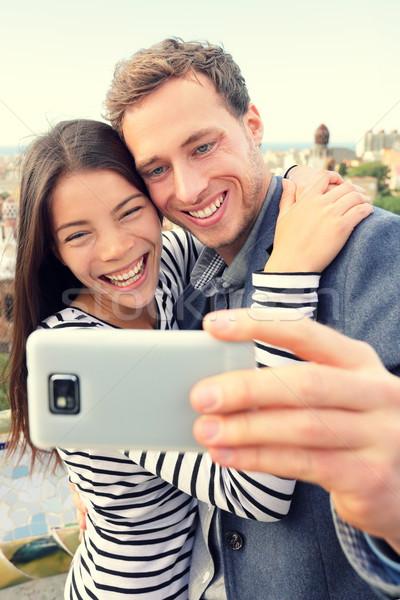 Selfie smartphone self-portrait by happy couple. Stock photo © Maridav